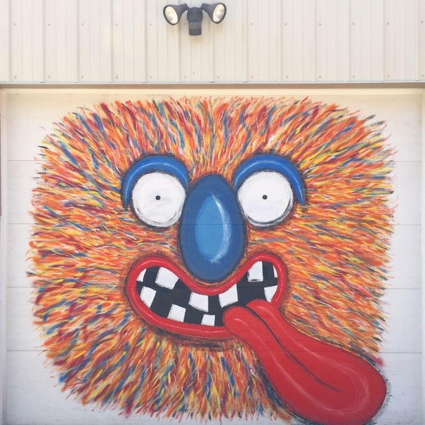 mural of colorful furry cartoon character painted on garage door, Pittsburgh, PA