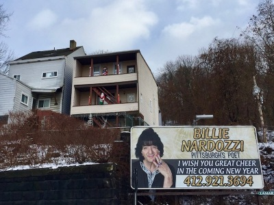 "billboard with Billie Nardozzi's picture and the text ""I wish you great cheer in the coming new year,"" Pittsburgh, PA"