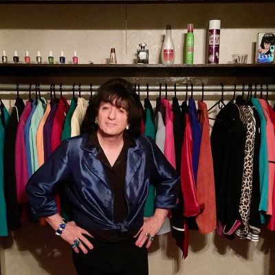 Billie Nardozzi in front of a closet full of colorful women's blazers