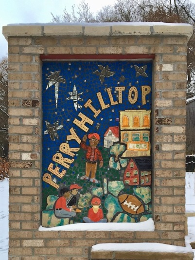brick and mosaic neighborhood welcome sign for Perry Hilltop, Pittsburgh, PA