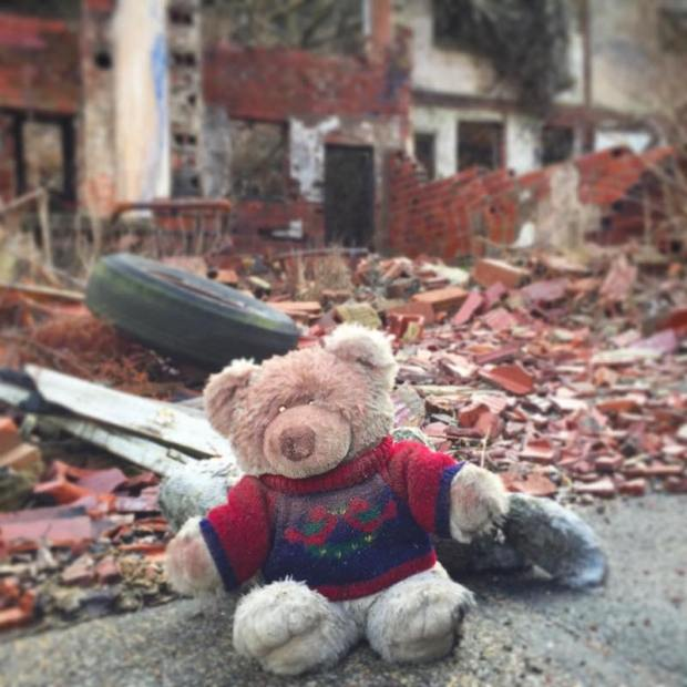 stuffed teddy bear in front of demolished house, Clairton, PA