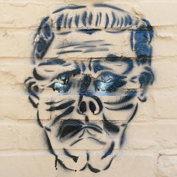 stencil image of monster's head painted on brick wall, Pittsburgh, PA