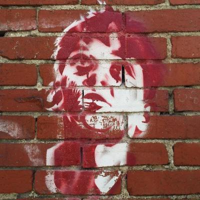 stencil image of man's face painted on brick wall, Pittsburgh, PA