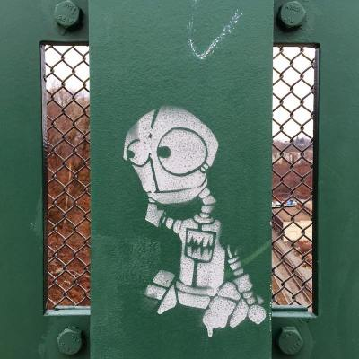 stencil image of cartoon robot painted on bridge, Pittsburgh, PA