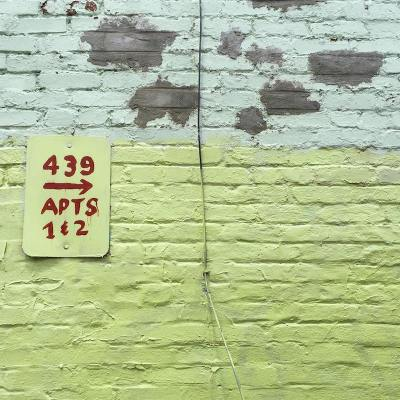 brick wall painted green and aqua with homemade address sign, Pittsburgh, PA