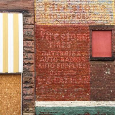 alley wall with ghost signs and many materials, Butler, PA