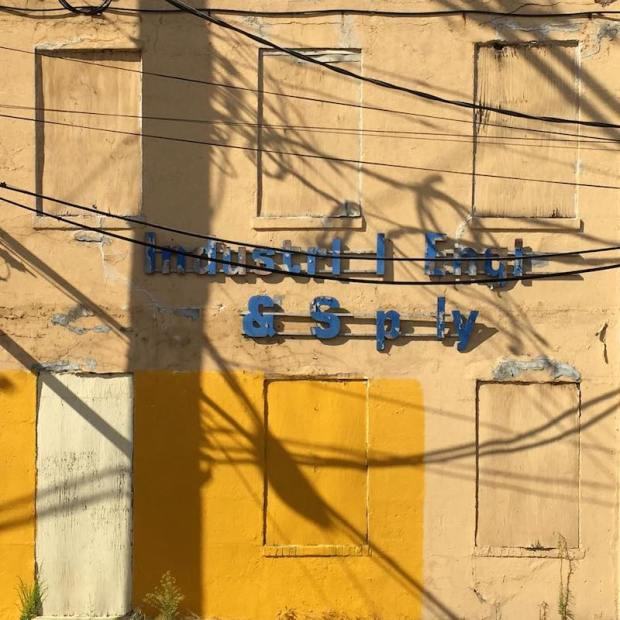 facade of building with shadows of telephone pole and wires, Pittsburgh, PA