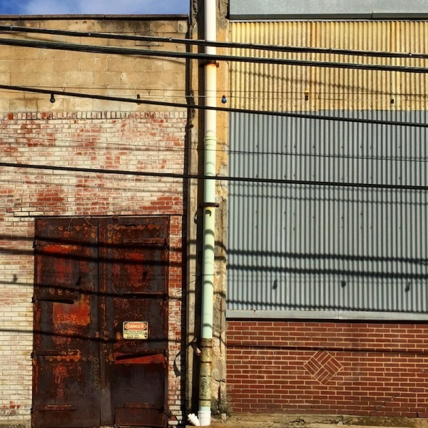 weathered brick and sheet metal factory wall, Etna, PA