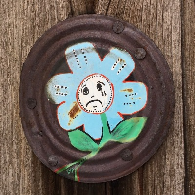 can lid painting of flower with crying face, Pittsburgh, PA