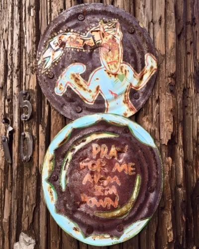 tin can lids painted and nailed to a utility pole, Pittsburgh, PA