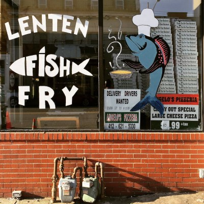 front windows decorated for Lenten Fish Fry, Angelo's Pizza, Pittsburgh, PA