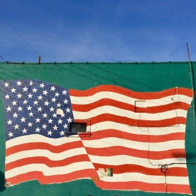brick wall painted with American flag mural, Verona, PA