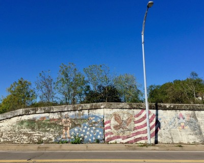 concrete roadside wall painted with American flag, McKees Rocks, PA