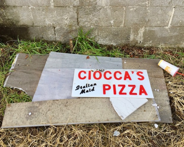 sign for closed pizza shop in alley, Etna, PA