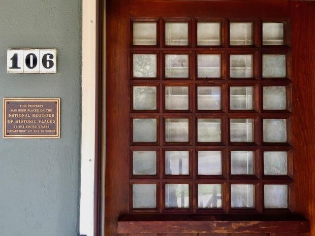 wooden door detail showing 30 small window panes