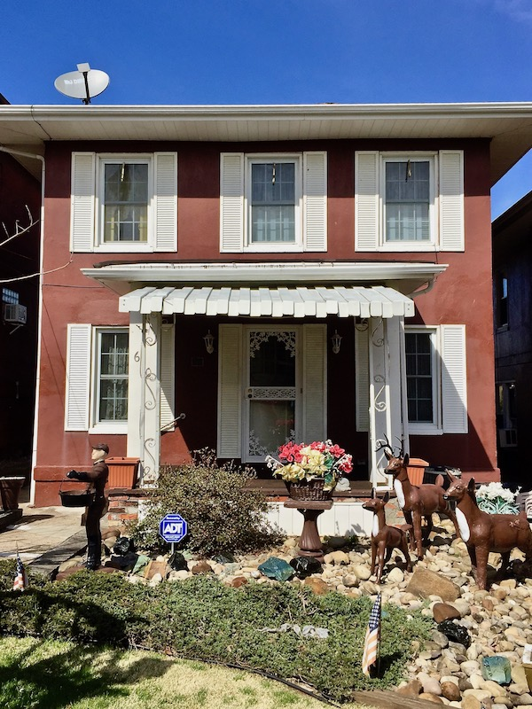 cement house in Donora, PA with lawn statuary and porch modifications