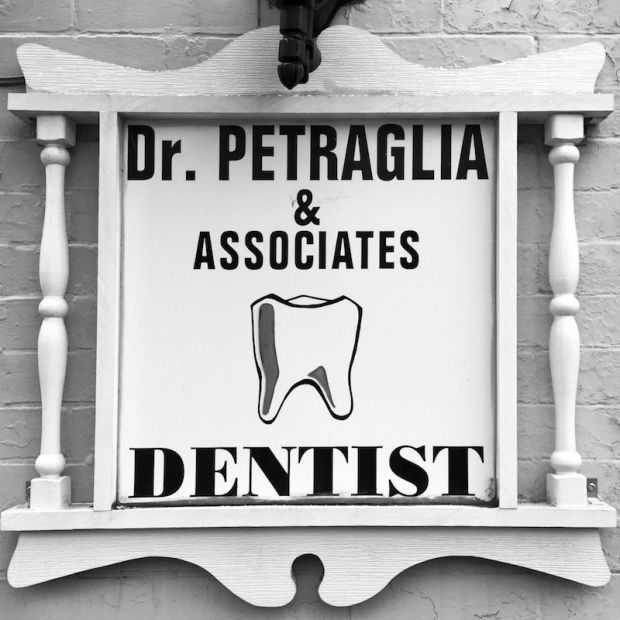wooden sign for Dr. Petraglia & Associates dentist office, Pittsburgh, PA