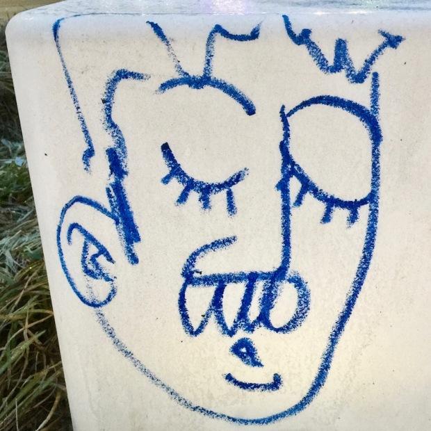 graffiti cartoon figure drawn on street feature