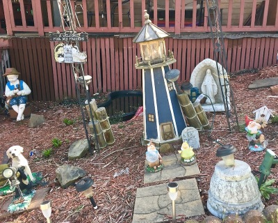 front yard covered with decorative figurines, lighthouse, and Mary statuette, Donora, PA