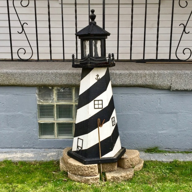 decorative lawn lighthouse against front porch, Neville Island, PA