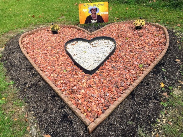 roadside memorial heart with sign