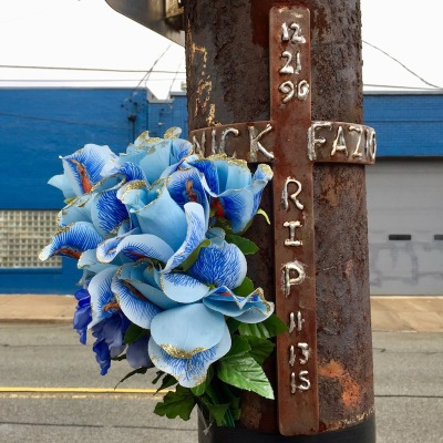 iron memorial cross with plastic flowers on utility pole, Pittsburgh, PA