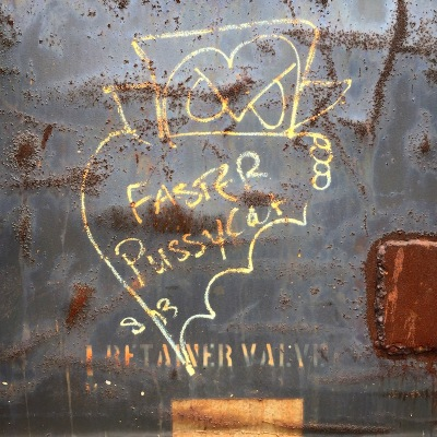 "graffiti cartoon of a vampire with ""Faster Pussycat"" written on his cloak, Neville Island, PA"