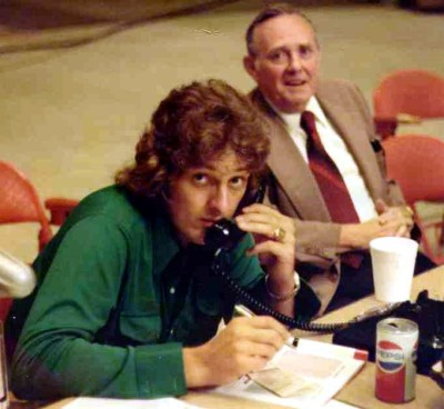 Danny McGibbeny on telephone at World Team Tennis match in the 1970s