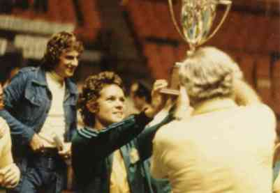 tennis star Evonne Goolagong-Cawley holding a trophy for the World Team Tennis Cup, 1975