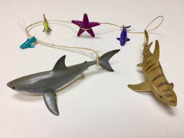 6 plastic sea creature toys connected by twine