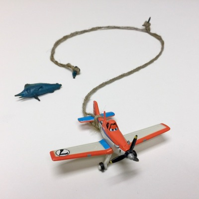 toy airplane on string of twine