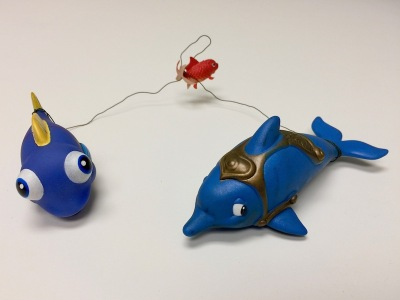 3 toy fish connected by wire