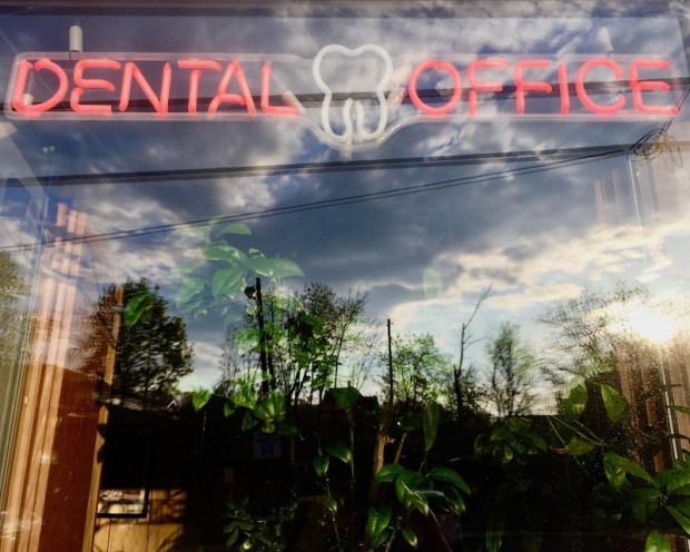 neon sign with tooth shape in dentist's office window, Bridgeville, PA