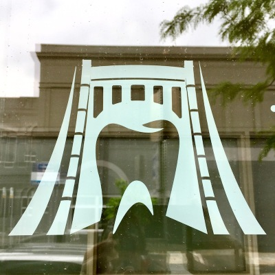 logo for Merit Dental of a combined bridge and tooth