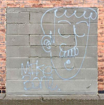 graffiti image of man with mustache on cinderblock wall, Pittsburgh, PA