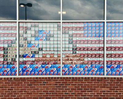 grocery store display of soda pop packaging made to look like a bald eagle