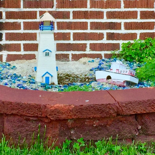 small planter with model lighthouse and boat, Pittsburgh, PA
