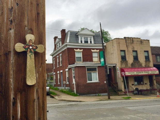 wooden cross attached to utility pole, Pittsburgh