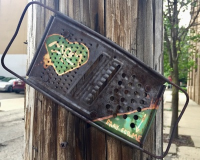 painted cheese grater nailed to utility pole, Pittsburgh, PA