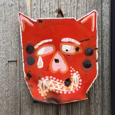 steel can painted with sad devil and nailed to utility pole, Pittsburgh, PA