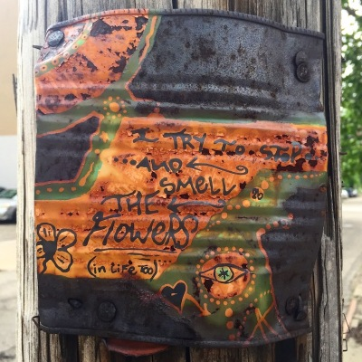 steel can with painting nailed to utility pole, Pittsburgh, PA