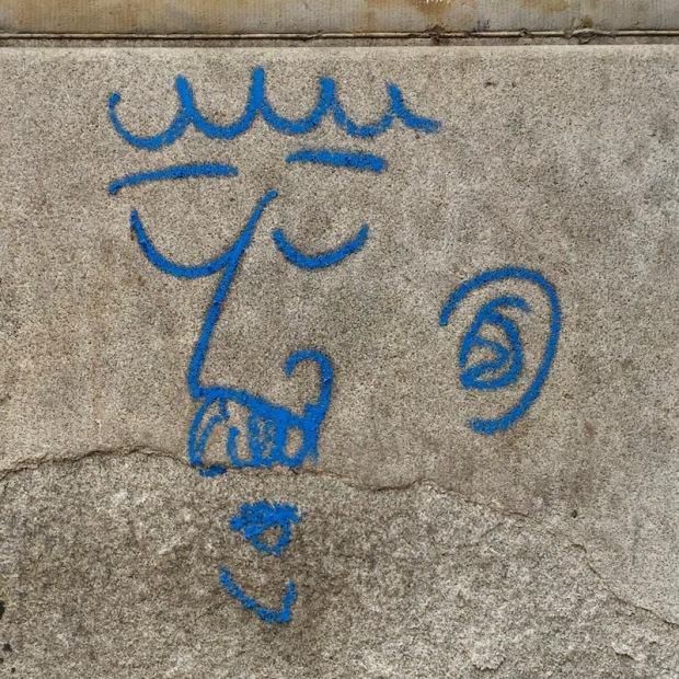 graffiti of man's face with bushy mustache on stone wall, Pittsburgh, PA