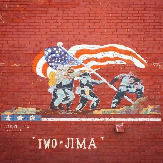 mural of American soldiers raising flag at Iwo Jima painted on red brick wall of house in Johnstown, PA