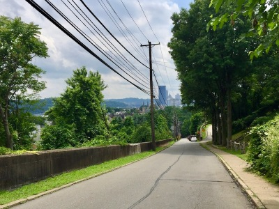 empty street with distant view to downtown Pittsburgh, PA