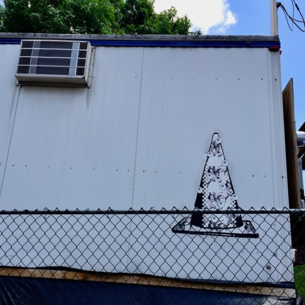 wheatpaste traffic cone with eyeballs on construction trailer, Pittsburgh, PA
