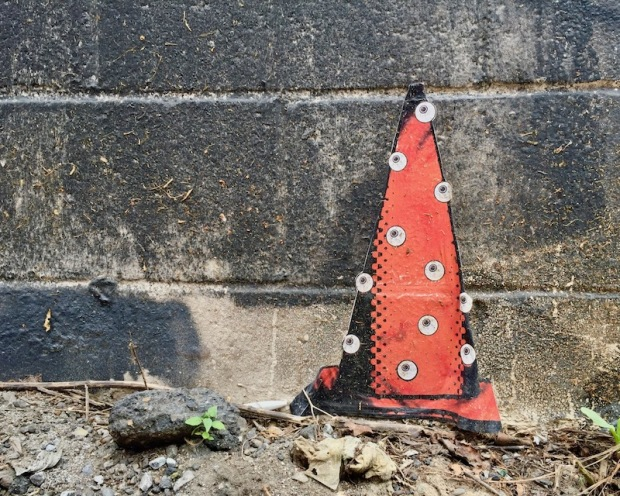 wheatpaste traffic cone on cinderblock wall, Pittsburgh, PA