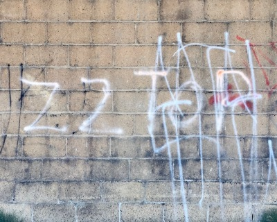 spray paint graffiti on cinderblock wall for ZZ Top, Homestead, PA