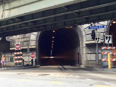 exterior of Armstrong Tunnel with rising highway structure above, Pittsburgh, PA