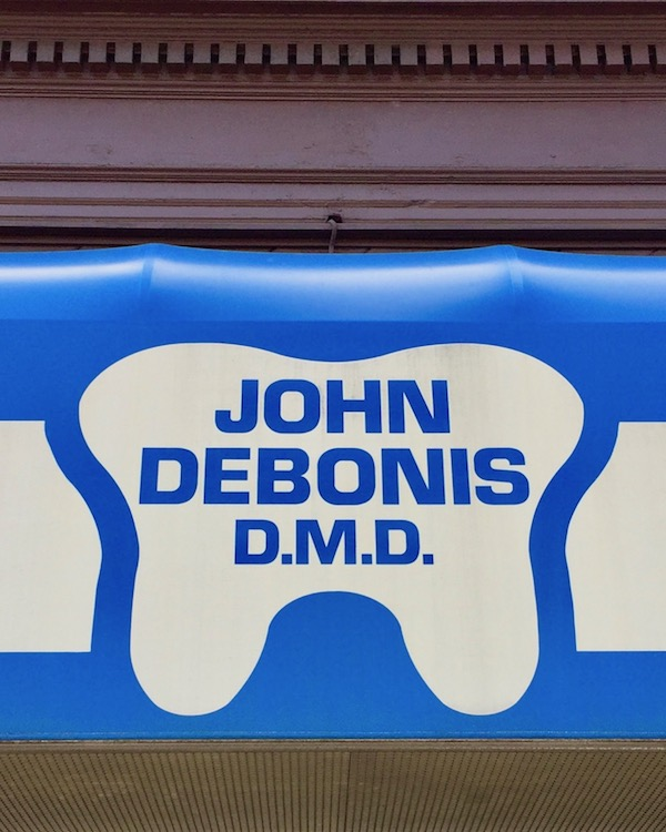 awning for dentist John Debonis with tooth-shaped logo, Bellevue, PA
