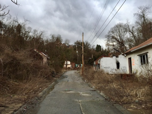 single-lane residential street with abandoned houses, Clairton, PA